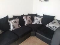 LARGE FULLY REUPHOLSTERED BLACK CORD CORNER SOFA DELIVERY INCLUDED.