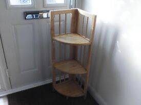 Pine corner unit. Ideal for displaying items. Very good condition. It also folds down if required.