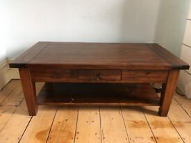 Solid wood coffee table with a shelf and drawer