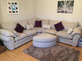 Large corner sofa with matching footstool