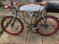 Brand new single speed bike with locker, lights and helmet.