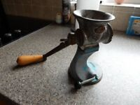 antique mincer - working - kitchen bench - makes mince meat