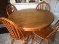 brown kitchen table with 4 chairs