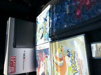 Black Nintendo 3ds XL and games