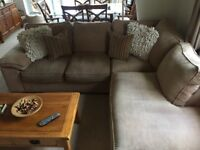 Corner sofa, chair and foot stool - beige/oatmeal. Used but very comfy. Sofa sits 4 comfortably.