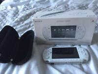 White PSP boxed with 4 games and carry case