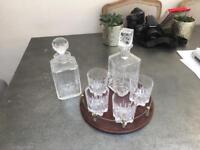 Two crystal decanters, crystal whisky glasses and a little monogany tray