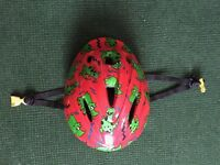 Child's bike helmet. Red with cute dinosaur design. Boy or girl. Age 3-6 years