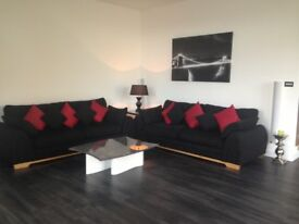 TWO LARGE CHUNKY BLACK 3 SEATER SOFAS