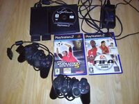 Sony Playstation 2 + Two controllers + 3 Games + 2 Memory Save Cards