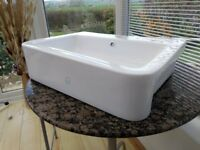 Very contemporary, funky, white bathroom sink