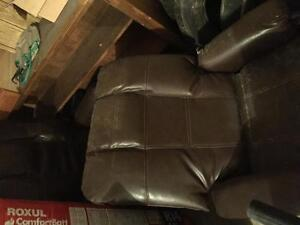 Brown leather rocking chairs
