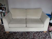 Very comfortable cream 2 seat sofa - excellent condition