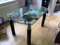 Extendable glass dining table and 6 faux leather chairs