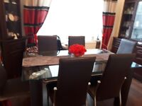 Glass 2 Tier Dining table and 6 leather effect chairs