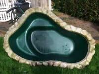 Ornamental garden fish pond