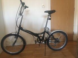 Argos folding bike + helmet