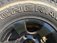 Nissan NAVARA D22 black alloy wheels with general grabber at2 tyres x4