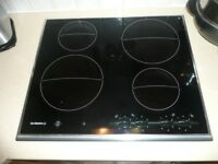 De Dietrich black ceramic hob and matching extractor hood