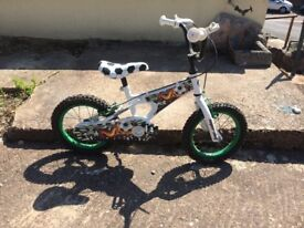 Bike with football decoration and stabilisers