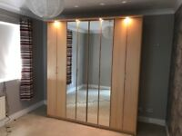 Big wardrobe with mirror doors