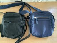Two man bags. One black ,one blue.