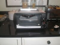 Counter top electric oven and griddle