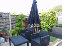 new rattan effect outdoor seating set with 3 metre umbrella all in black