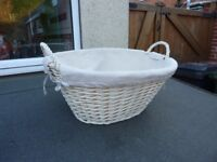 Wicker basket with linen liner.