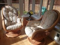Two conservatory chairs and matching coffee table.