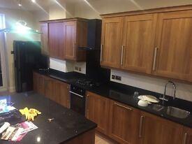 Gorgeous light walnut kitchen cupboards, doors and granite worktop