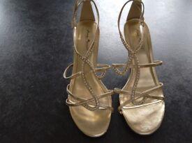 Worn Gold metallic sandals size 5