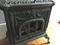 French traditional cast iron log burner with side door and front window. Needs refurbishment.