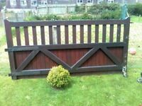 large solid wood driveway gate