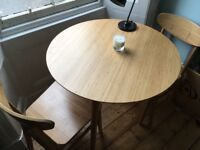 Bamboo Ikea round table with 2 chairs.