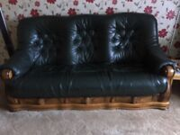 3 seater settee + 2 chairs + footstool sleigh style in green leather from smoke & pet free home