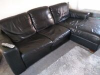 black leather reclining sofa and armchair
