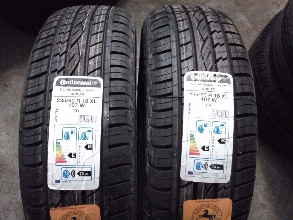 4 BRAND NEW CONTINENTAL CROSS CONTACT 235/60.R.18 107 V