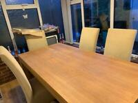 Wood dining table and six cream upholstery chairs. Buyer collects. Must go