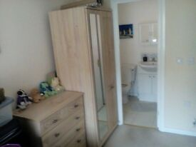 4piece bedroom suite consisting 2 wardrobes dressing table and chest of draws