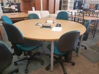 Round meeting table with retractable power points