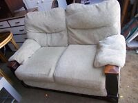 A two seater settee in oatmeal