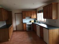 Second hand solid timber kitchen for sale with appliances.