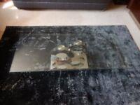 Top quality Contemporary glass and chrome coffee table.130cm long x 70cm deep x 37cm high.