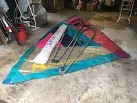 Windsurfing equipment. 2 sails, 2 booms, 4m board, 14 foot mast. Good condition