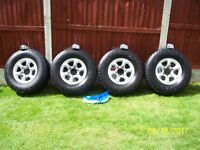 Mitsubishi shogun pajero L200 4x4 alloys with 2 months old tyres plus centre caps and wheel nuts.