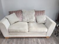 2 x 2 seater cream sofas from DFS only used occasionally, in good condition.