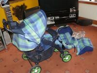 Blue checked style pushchair and car seat - barely used and clean and packs away easily