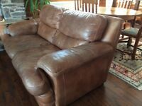 Three seater and two seater light brown sofas in cowhide leather.