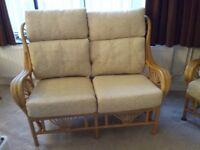 A 4 piece set of cane conservatory/summerhouse furniture